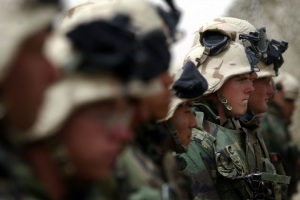 KUWAIT--Young United States Marines Echo Company Infantry, stand at attention while listening to Col.O'Donohue, Battalion commander of the 2nd Battallion 5th Marines, before they are sent into battle Thursday morning, Kuwait time at a DA camp, dispersal a
